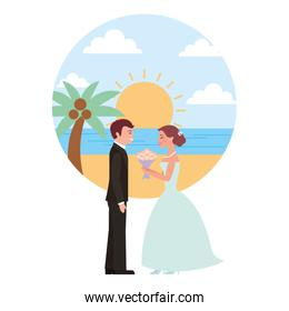 married couple in beach with bouquet of flowers