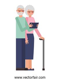 cute grandparents with tablet device