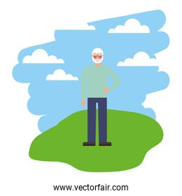 cute grandfather in grass with sky