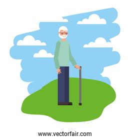 cute grandfather with walking stick in grass
