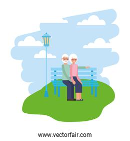 cute grandparents in park chair and landscape