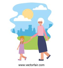 cute grandmother with granddaughter in landscape
