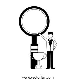 businessman with trophy and magnifying glass
