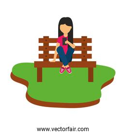girl using smartphone sitting on bench park