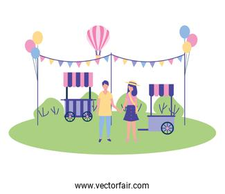 couple holding hands in the park  with garland balloons