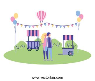 couple holding hands in the park booth garland balloons