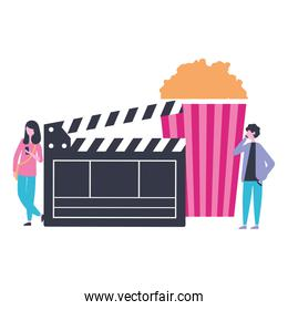 man and woman popcorn and clapperboard production movie film