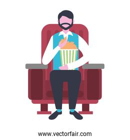 man sitting in cinema chair watching movie