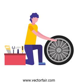 mechanic worker with tyre and toolkit