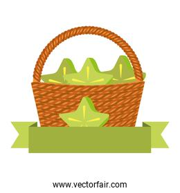 wicker basket with fresh carambola