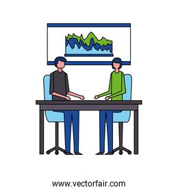 man and woman in the offfice with presentation board
