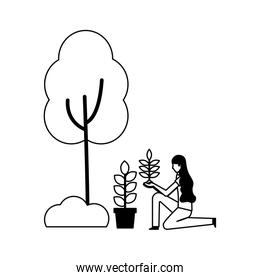 woman with plant in pot planting tree