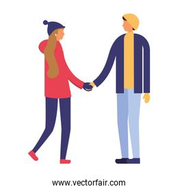 couple holding hands with winter clothes
