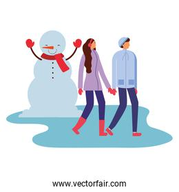 couple holding hands and snowman winter