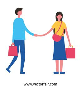 couple holding hands with shopping bags