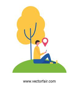 man sitting near tree with mobile location