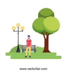man using mobile in the park