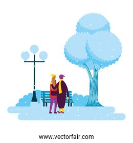 couple in the park winter scenery