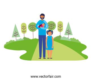 father carrying baby and daughter in the park