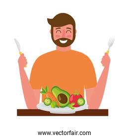 bearded man with fresh vegetable and fork knife