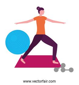 woman making yoga with mat and dumbbells