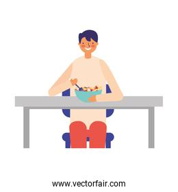 man sitting eating fruits in plate