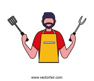 man holding fork and spatula