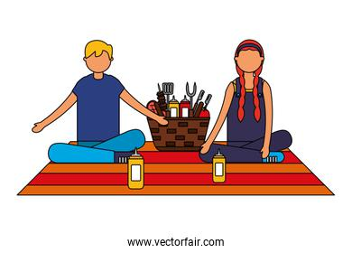 couple sitting picnic basket with barbecue utensils