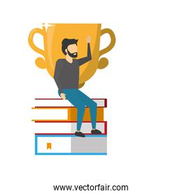 man sitting books pile with trophy