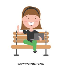 woman sitting with laptop on bench
