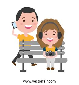 girl using earphones and man with mobile