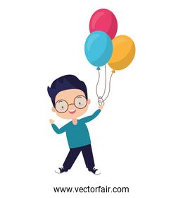 young boy holding balloons helium