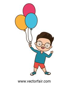 young boy holding balloons