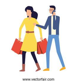man using smartphone and woman with shopping bag