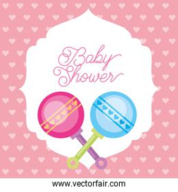 pink and blue toy rattles hearts background baby shower card