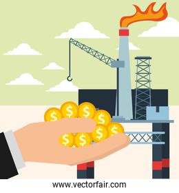 hand with coins and chemical plant oil industry