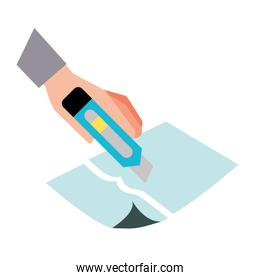 hand with the tool cutting a paper