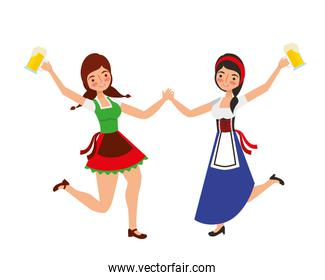 two bavarian women dancing with beers