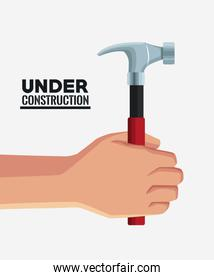 Hand with construction tool