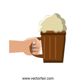 Hand with beer on wooden cup