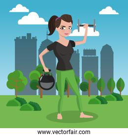 Fitness woman with weigths on park