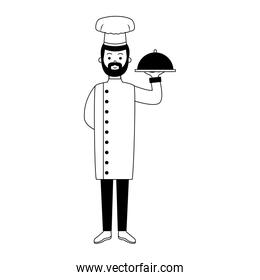 Male chef holding dish in black and white