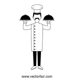 Male chef holding dishes in black and white