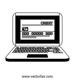 Magnifying glass on laptop with credit card in black and white
