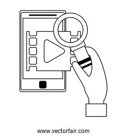 Hand with magnifying glass checking video on smartphone black and white