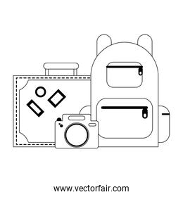 travel suitcase camera and backpack in black and white