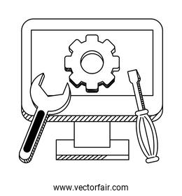 technical support computer with tools in black and white