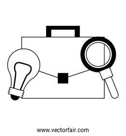 light bulb, briefcase and magnifying glass in black and white