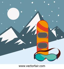 snowboard and glasses with mountains landscape