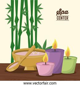 color poster of spa center with bamboo plant and set of candles and bowl